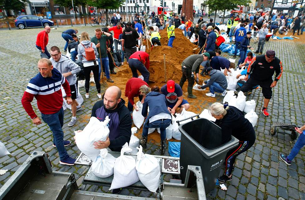 Residents collected sandbags after heavy rains in Erftstadt, Germany on Friday.