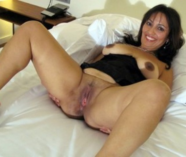 Tanned Brazilian Milf With Big Breasts Posing Only In Small Shorts