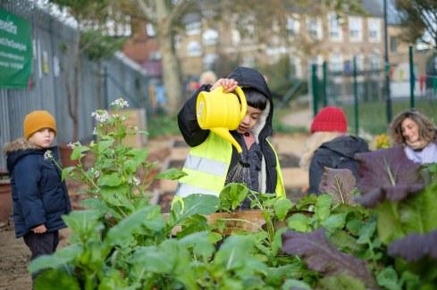 Children gardening in community garden
