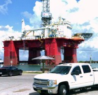 Photo taken by D. Cooper © Chevy and Oil Platform in inlet (TX)