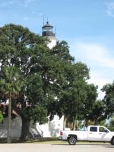 Photo by H.S. Cooper © Chevy and lighthouse (FL)