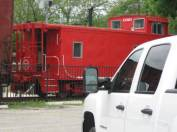 Photo by H.S. Cooper © Chevy and caboose (TX)