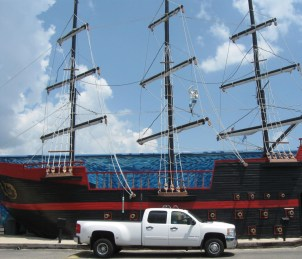 Photo by H.S. Cooper © Chevy and pirate ship (AL)