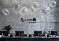 Jin Jiang og Radisson med co-branded hotell