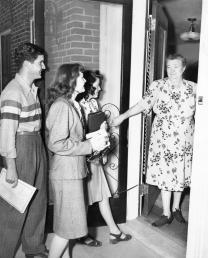 Pauline ushering students into class