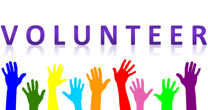 Volunteer with colorful hands