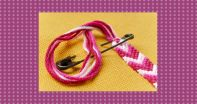 Image of safety pin and fabric