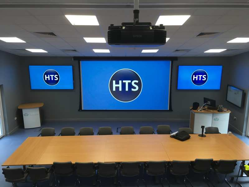 Conference venue equipped with a projector and screen and two repeater displays