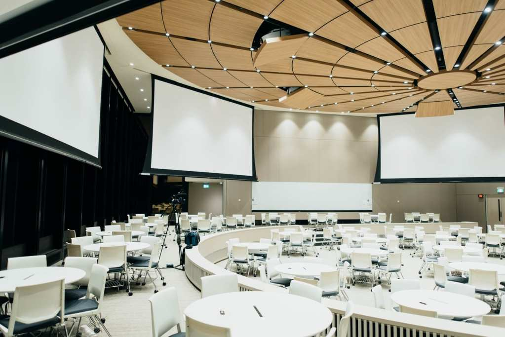 A conference using projectors and projection screen & audio