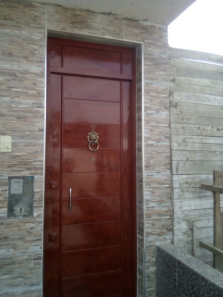 Puertas De Fierro Imitacion Madera  S 99000 en Mercado Libre