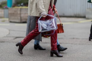 COPENHAGEN, DENMARK - FEBRUARY 01: A guest wearing a transparent loewe bag and Louis Vuitton boots, snakerskin pants outside Tonsure at the Copenhagen Fashion Week Autumn/Winter 17 on February 1, 2017 in Copenhagen, Denmark. (Photo by Christian Vierig/Getty Images)