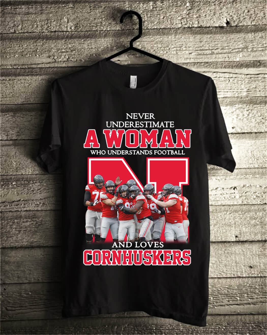 Never underestimate awoman who understands football and loves Cornhuskers shirt