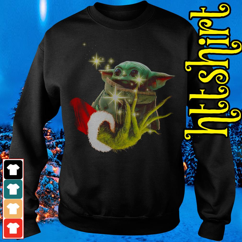 The Grinch holding a baby Yoda Sweater