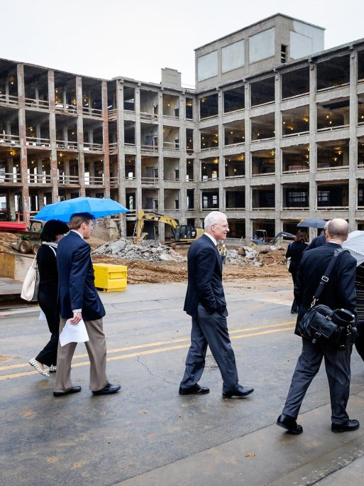 Senior Wake Forest University administrators tour the building while under construction.