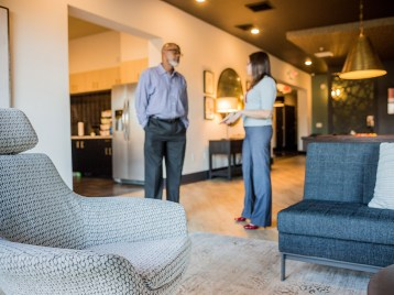 Suggs stands in the lobby of 757 North Apartments with the property manager.