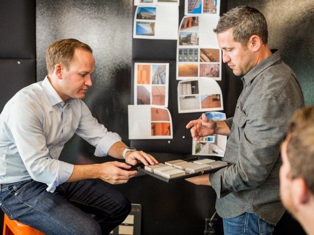 Pete Fala (right), Owner, STITCH Design Shop, pictured at work with a client