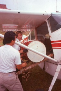 Dan Lenz loading barrel of fuel into plane