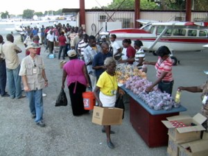 Food distribution at the MAF hangar on Feb. 22, 2010, for airport personnel & volunteers.