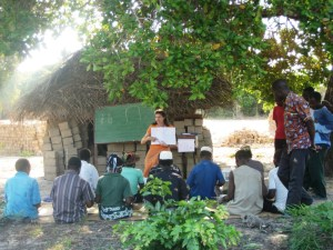 Literacy class to teach the Mwinika to read and write their own language. Photo from http://blogs.ntm.org/francois-hattingh