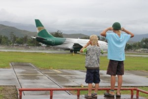 C.J. and Ryan, watching a jet land at the Wamena airport.