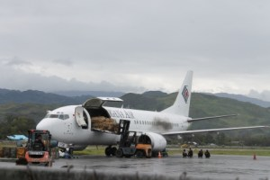 A jet unloading its cargo at the Wamena Airport.