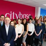 Staff of Citybase Apartments, Lancaster, return to new-look office