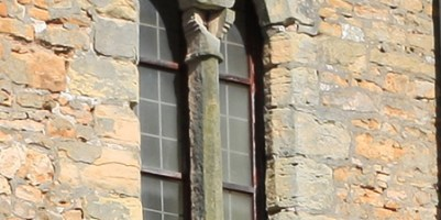 Close up of damage and erosion to south face tower window