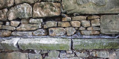 Close up of tower stonework with mortar removed, ready for repointing