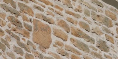 Close up of cleaned and repointed tower stonework