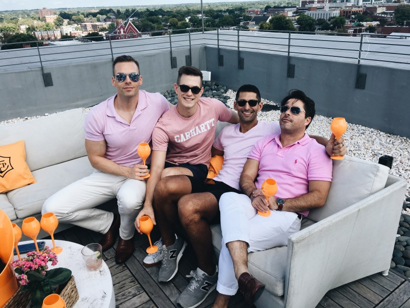 Guys in pink at Quirk Hotel's bubbly bash