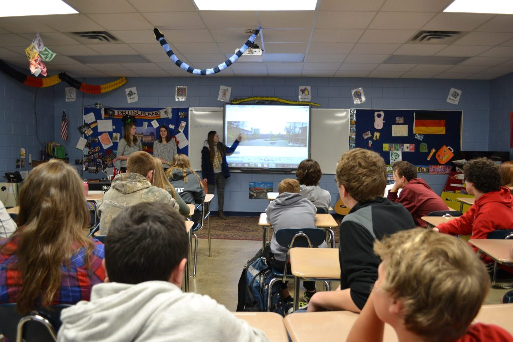 A view of a high school classroom with student attention directed at the front of the class.