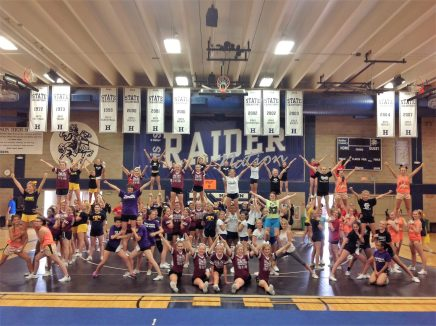 High school gymnasium is filled with cheer leaders as part of western Wisconsin cheer clinic.
