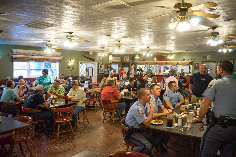 Image of Hudon's Hickory House interior with GA State Patrol