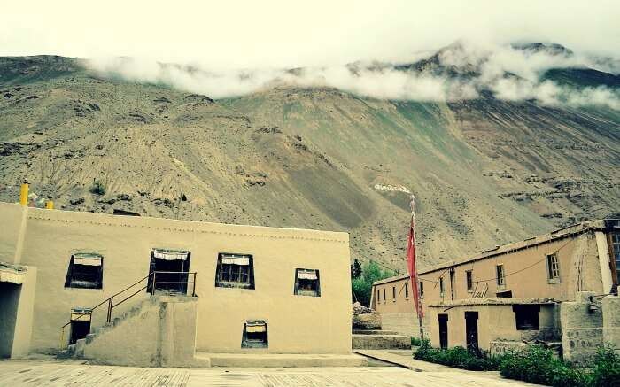 Inside Tabo monastery in Spiti along with barren mountains background