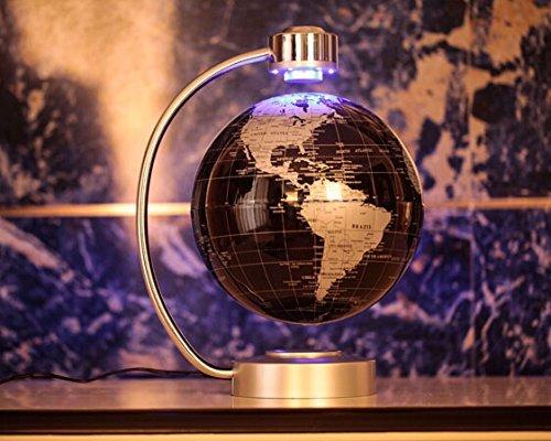 globe terrestre en lévitation couleur or