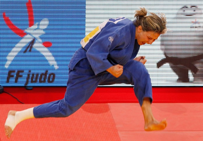 Portugal's Telma Monteiro celebrates after defeating Japan's Aiko Sato in their under -57 kg final at the Paris International Grand Slam judo tournament