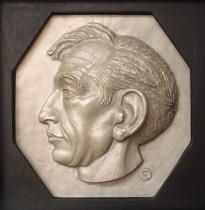 A self portrait in relief by Hugo Powell