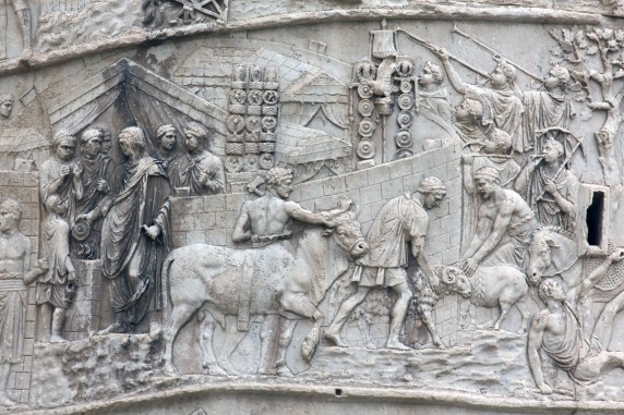 Scene 8 in situ: Trajan pours an initial libation (left) as the victimarii lead the pig, ram, and bull to sacrifice. The procession moves around the walls of the camp, led by musicians. The military standards, including the aquila, have been set up at the center of the camp. RBU2013.2069