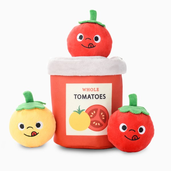 a tomato can with 3 tomato dog toy