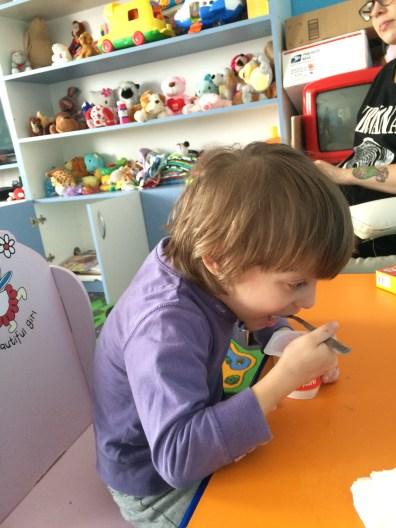 Luciana loving her yoghurt