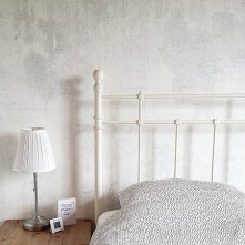 betonnen muur slaapkamer