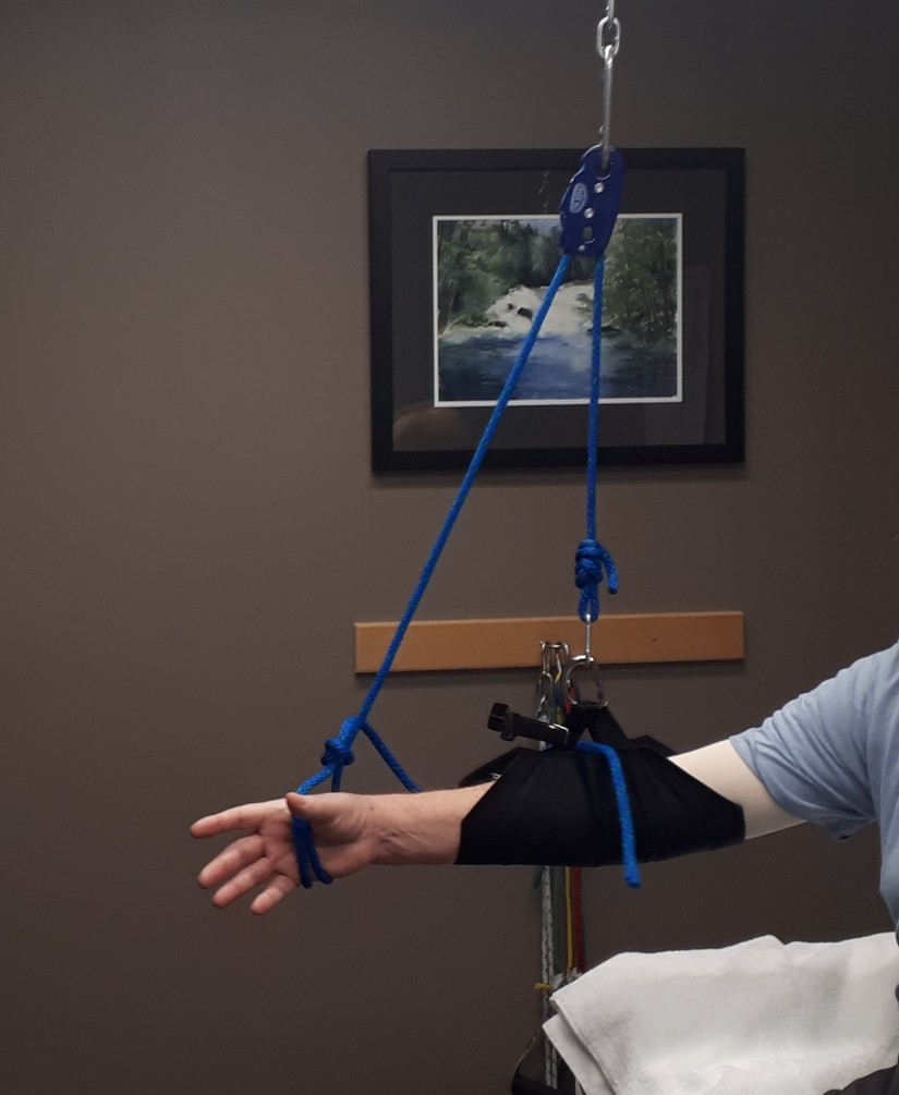 An sling supports the arm during exercises following shoulder surgery.