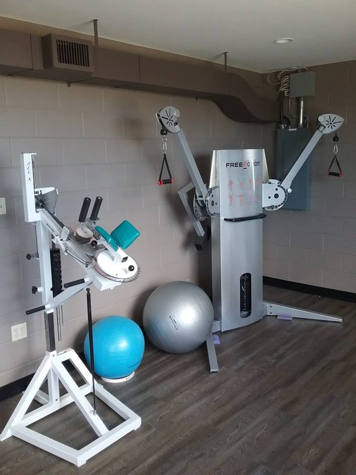 Our Advanced Shoulder Room includes exercises and equipment for stretching and strengthening, including the Free Motion machine, exercise balls, and Roto-Cuff machine pictured here.