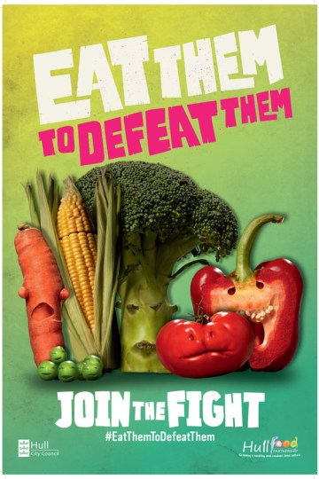 """Photo shows photo shopped vegetables with menacing mouths. It says """"eat them to defeat them"""" in large text across the vegetables."""