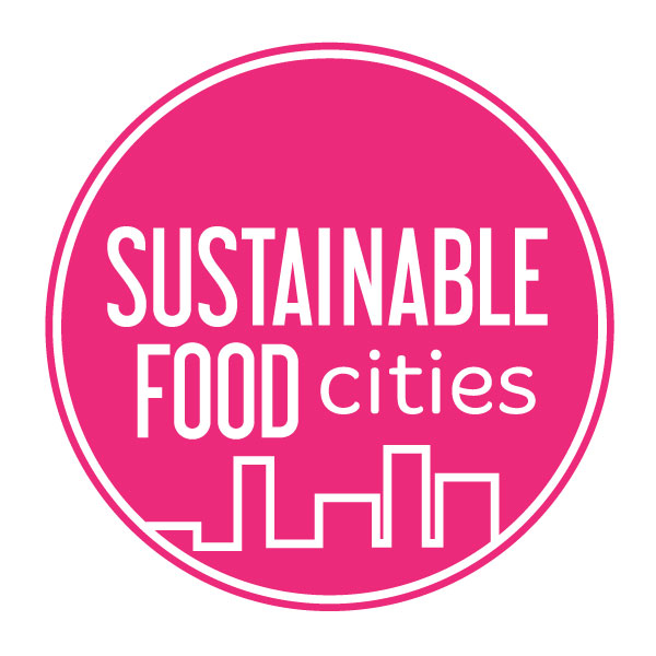 "A pink, cicular logo with ""Sustainable food cities"" and an illustrated outline of a cityscape"
