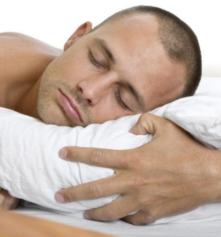 sleeping with arm under pillow and head