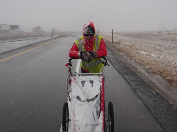 "Christina Lee with her stroller ""Thor"" during a Wyoming snowstorm."