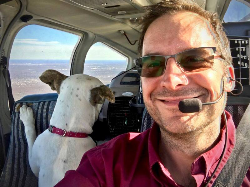 Paul Steklenski with a co-pilot. Credit Flying Fur Animal Rescue