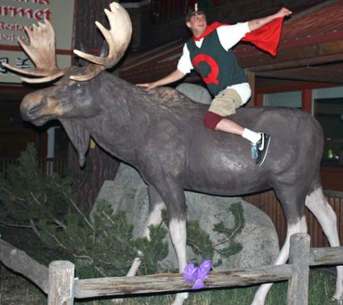 Matthew Manguso riding the moose statue in Pinedale on Halloween.