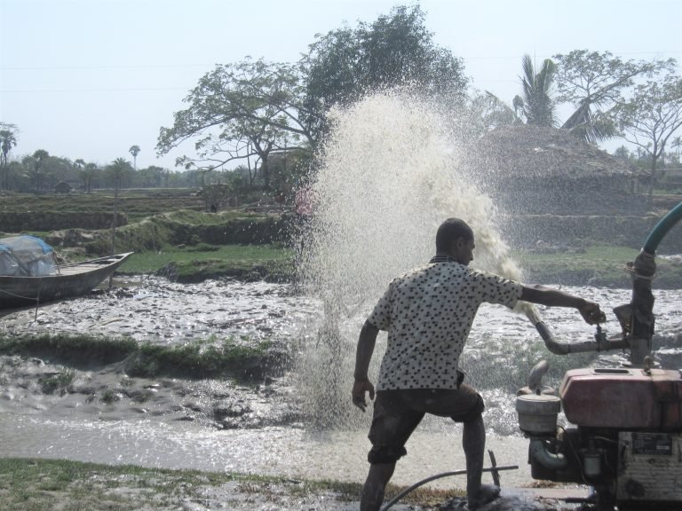 A farmer in Bangladesh, one of the most vulnerable places, pumps water through an irrigation system. (Kevin Krajick/Earth Institute)